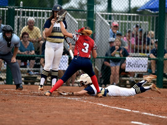 Lindsey Davis, of Aucilla Christian, slides safe into home plate in front of Masters Academy pitcher Chloe Fowler in the bottom of the third inning of their Class 2A state semifinal game at Historic Dodgertown on Monday, May 21, 2018 in Vero Beach. Aucilla Christian won the game, 4-0.