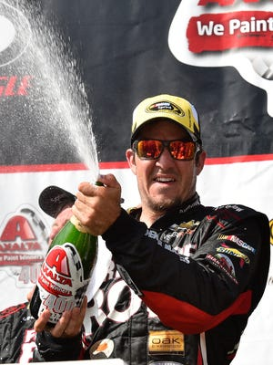 Martin Truex Jr. celebrates in Victory Lane at Pocono Raceway after winning Sunday.