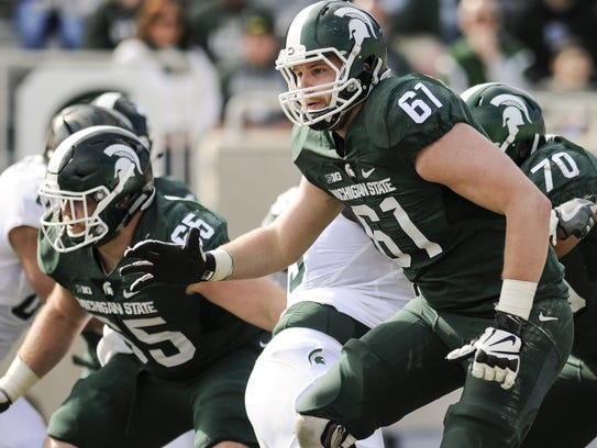 Left tackle Cole Chewins (61) and center Brian Allen