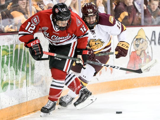 St. Cloud State defensive player Jack Ahcan (12) competes