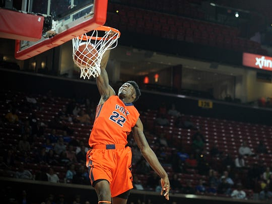 Poly's De'Vondre Perry throws down a jam in the MPSSAA 3A state semifinals at the Xfinity Center in College Park on Thursday, March 9, 2017.