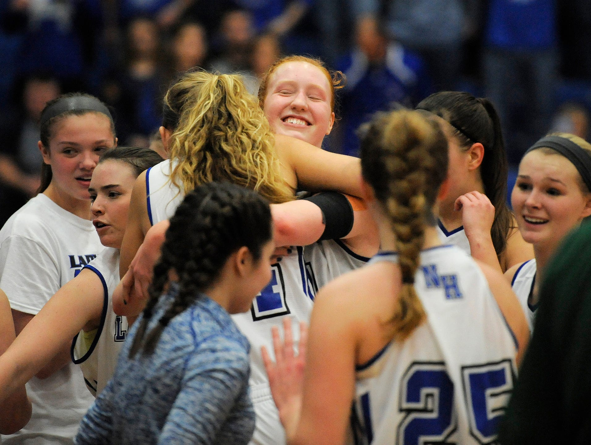North Harrison's Lilly Hatton (center) is all smiles as the Lady Cats celebrate their 61-48 win over Vincennes-Lincoln on Saturday during the 3A Regional Final game at Charlestown High School. North Harrison won 61-48. (Photo by David Lee Hartlage, Special to The Courier-Journal) Feb. 11, 2017