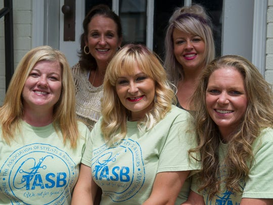 The staff at Salon 421 (clockwise from bottom right) Andi Adkins, Erica Pullum, Danyel LaRue, Samantha French and Heather Watson decided to be a part of a nationwide Cut-A-Thon for Autism taking place Aug. 25 and 26 at the salon located at 421 N Main St., Henderson.