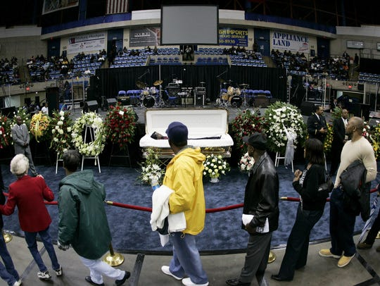 In this Dec. 30, 2006 file photo, mourners walk past