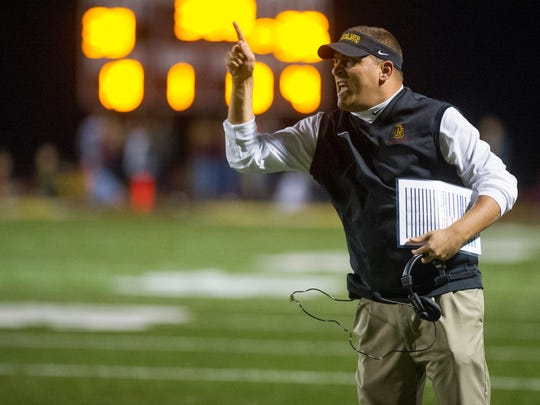 Gibson Southern's head coach Nick Hart yells down field