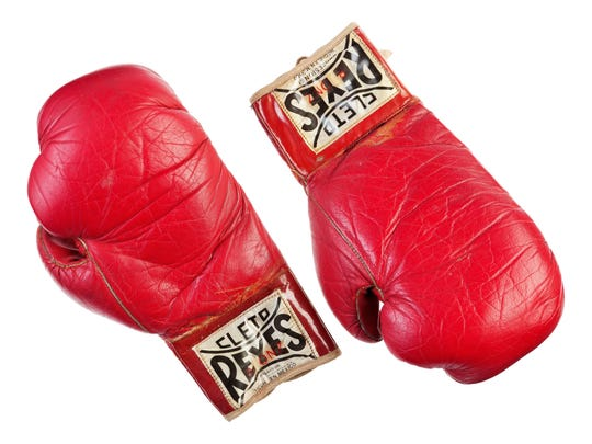 """Boxing gloves worn by Sylvester Stallone in """"Rocky II"""" (1979), that are among more than 1,400 costumes, props and personal items he's consigned to be sold at a public auction by Heritage Auctions in Los Angeles and online, October 14-15, 2015."""