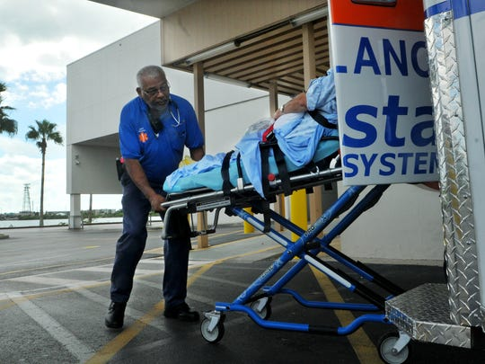 Personnel from Coastal Health Systems ambulance service evacuate patients from the Cape Canaveral Hospital in the days leading up to  Hurricane Matthew in 2016.