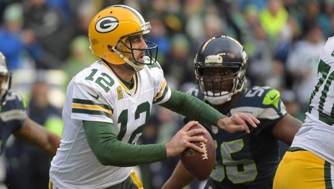 Jan 18, 2015; Seattle, WA, USA; Green Bay Packers quarterback Aaron Rodgers (12) looks to throw the ball against the Seattle Seahawks during the fourth quarter in the NFC Championship Game at CenturyLink Field.