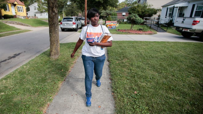 Maricha Butler canvasses Kennedy Heights in support of Issue 44.