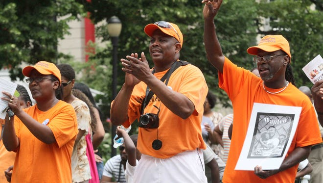 Ralph Woody (center) and Ronald Cephas (right) of Wilmington Peacekeepers, are seen during a 2012 rally.