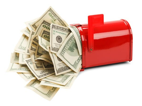 getty-passive-income-cash-delivery-checks-mail-mailbox-dividends-interest-benefits_large.jpg