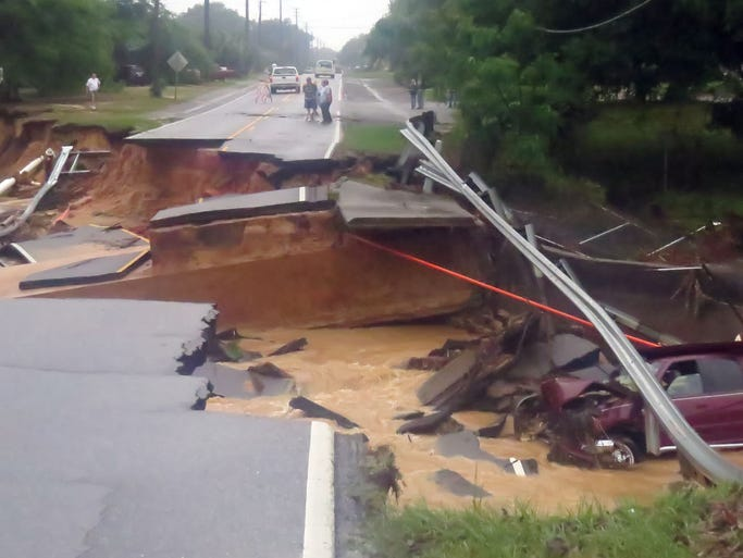 This section of Johnson Avenue washed out near the intersection of Olive Road.  Note the pickup truck at the bottom of the washout in the right side of the photo.