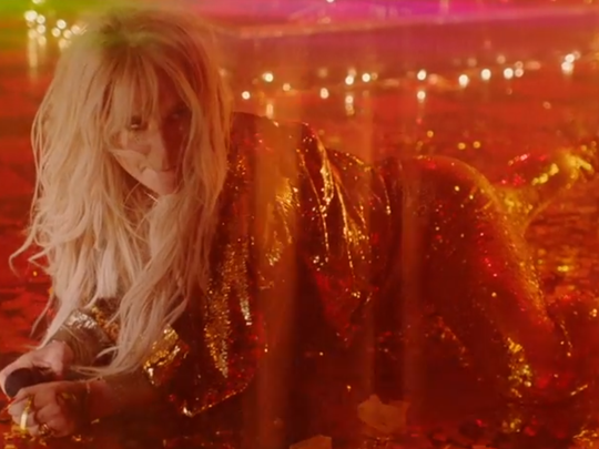 """Kesha as seen in her new music video for the song """"Woman,"""" which was shot at Wilmington's Oddity Bar. The song will appear on her next album, """"Rainbow,"""" due Aug. 11."""