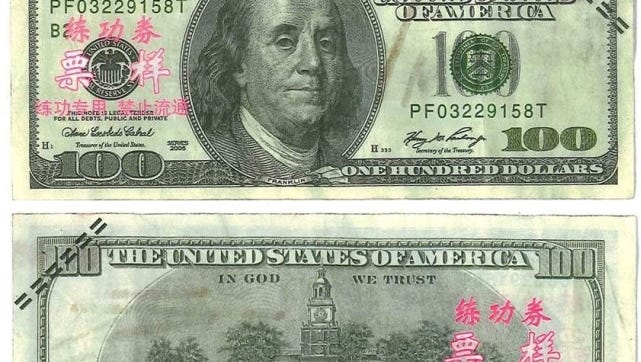 Counterfeit $100 bills have distinct markings, police said.