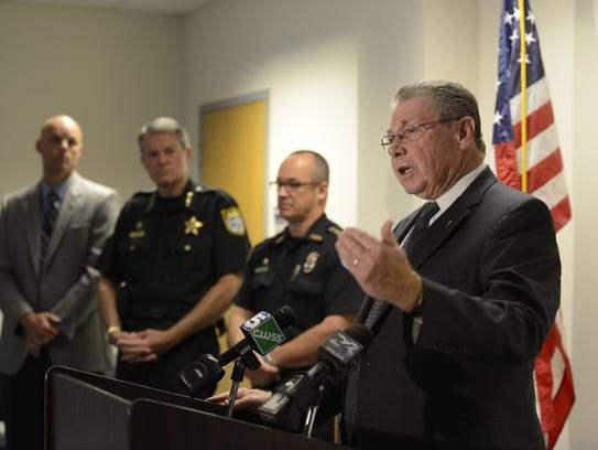 State attorney Bill Eddins, right, announces the arrest