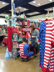 Patriot pajamas were modeled by one clerk as he made his sale at the annual Ruidoso Valley  Greeters Christmas Jubilee  featuring local merchants.