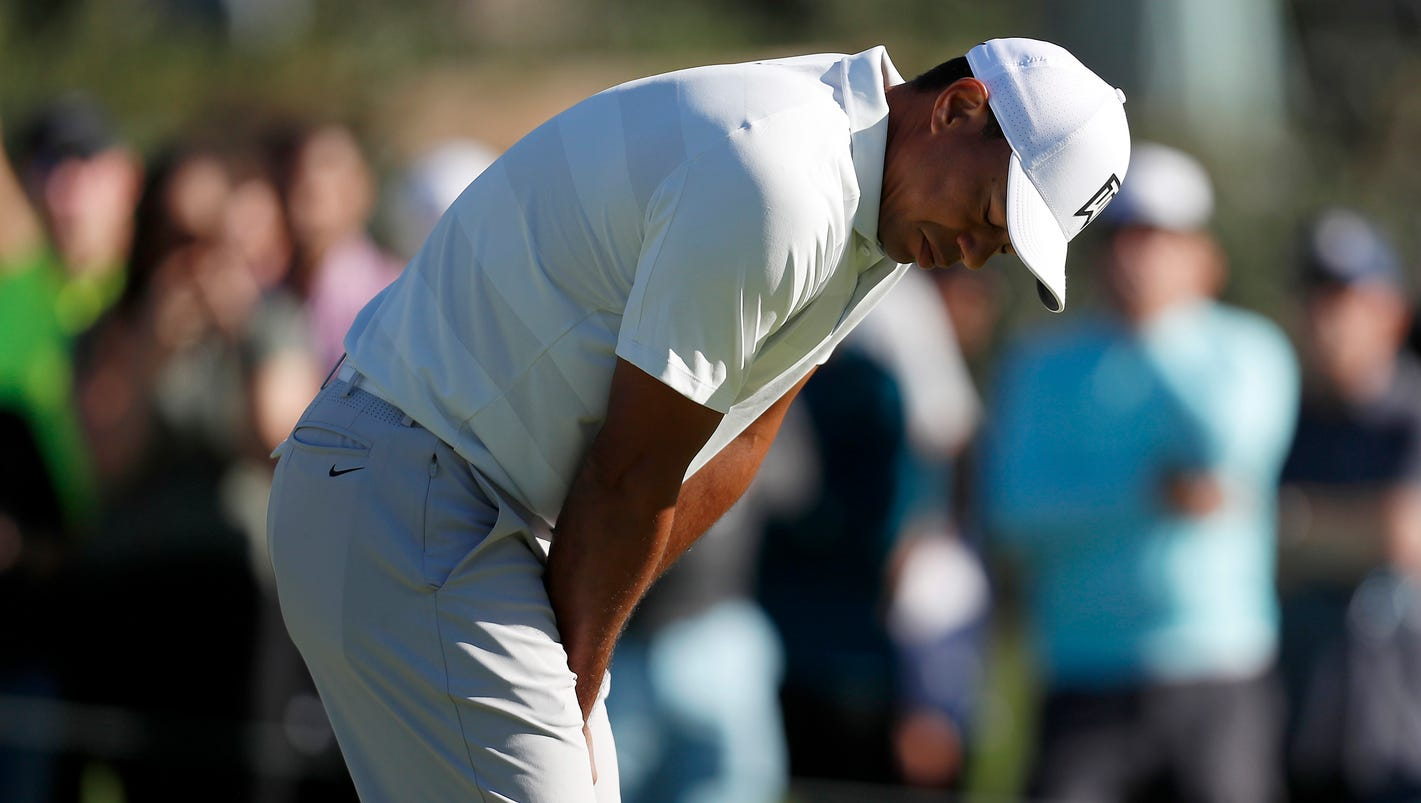Friday's golf: Woods misses cut for 1st time at Riviera