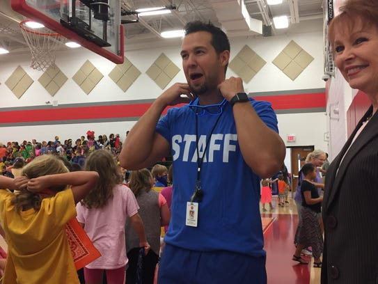 West Elementary Principal Chris Plummer, left, and