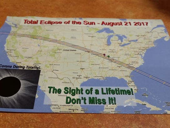 A postcard touts the path of totality for the Aug.