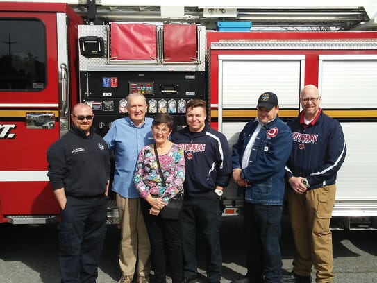 Joe and Reba Williams, second and third from left, celebrate their rescue from an elevator at Westgate Resort with Gatlinburg firefighters Sean McCune, left, Austin Vick, center, Capt. David Puckett and Fire Chief Greg Miller.