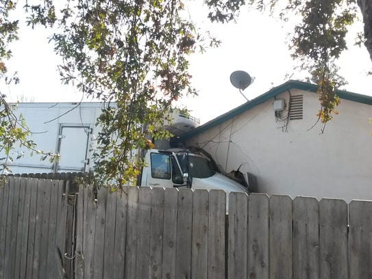A semi-truck crashed into the side of a Visalia home
