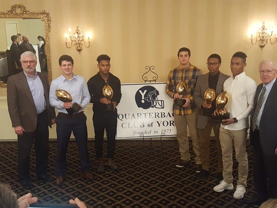 The Quarterback Club of York held it annual award banquet on Thursday. Pictured from left, are: Ed Bender (QB Club president), York Catholic's Kyle Dormer, Dallastown's Nyzair Smith, Delone Catholic's Zach Schussler, West York's Ay'Juan Marshall, York High's Robert Rideout and Roy Robbins of the QB Club. PHOTO BY RYAN VANDERSLOOT