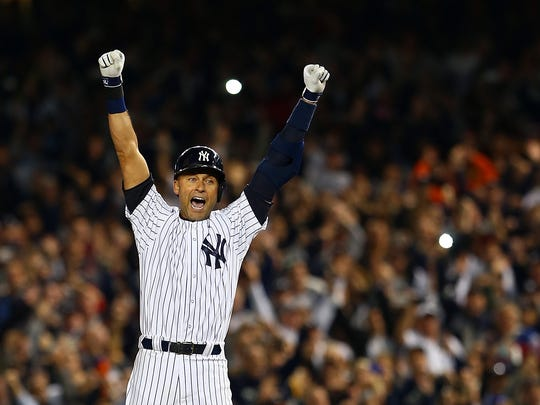 Derek Jeter celebrates his walk-off single in his final home game for the Yankees in 2014.
