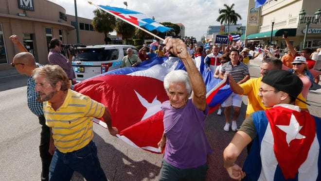 Cuban Americans celebrate the death of Cuban leader Fidel Castro on the streets in the Little Havana neighborhood of Miami Florida on November 27, 2016. /
