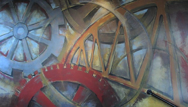 The mural at the Bistro at Towpath Cafe is an abstract representation of Fairport's Lift Bridge.