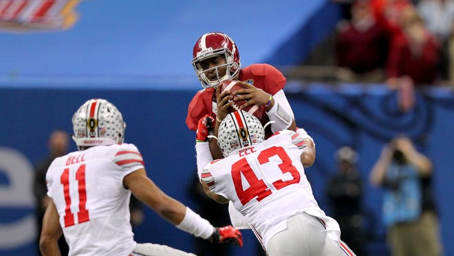 Alabama Crimson Tide quarterback Blake Sims (6) is stopped by Ohio State Buckeyes linebacker Darron Lee (43) as defensive back Vonn Bell (11) defends in the third quarter of the 2015 Sugar Bowl.
