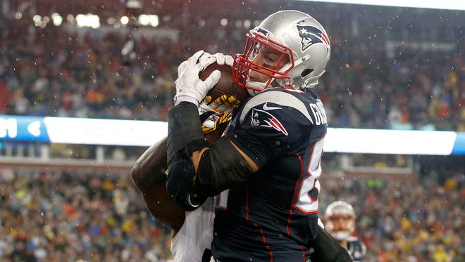 New England Patriots tight end Rob Gronkowski (87) catches a pass for a touchdown during the fourth quarter against the Pittsburgh Steelers at Gillette Stadium.