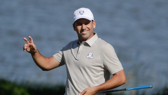 FILE- In this Saturday, Oct. 1, 2016 file photo, Spanish golfer Sergio Garcia reacts after making a birdie on the seventh hole during a four-ball match at the Ryder Cup golf tournament, at Hazeltine National Golf Club in Chaska, Minn. For more than 200 days, Garcia was the subject of a relentless Twitter campaign from one of his big fans. Mark Johnson, an Englishman, just wanted one thing: To be Garcia's caddie for a day.  (AP Photo/Chris Carlson, File) ORG XMIT: LON811