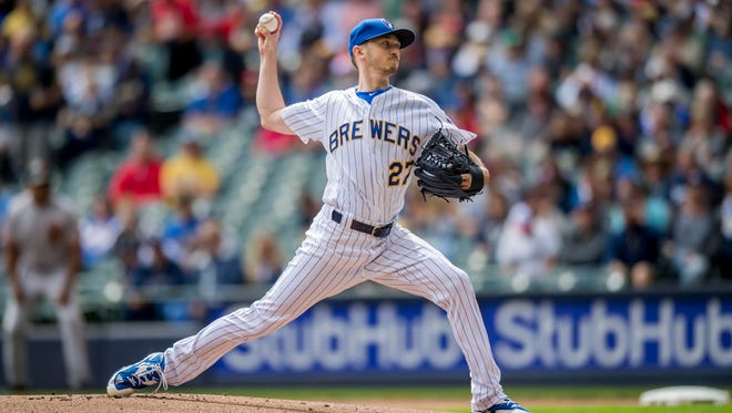 Brewers starting pitcher Zach Davies works against the  Giants at Miller Park on Sunday afternoon.