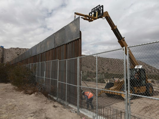 Image result for america builds mexico wall higher