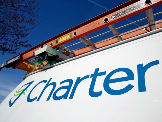 AP EARNS CHARTER COMMUNICATIONS F FILE A USA MO