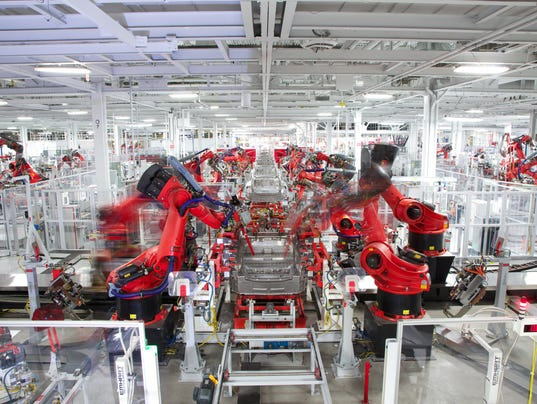 Tesla Fires Hundreds As Model 3 Electric Car Production Drags
