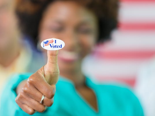 Happy African American woman with an I Voted sticker