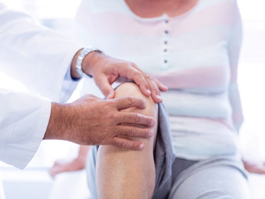UVM Medical Center - Physiotherapist giving knee therapy to senior woman