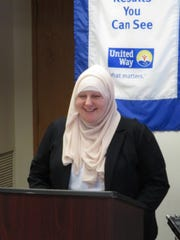 JoAnn Encarnacion, an intake administrative support specialist at the Women's Opportunity Center, speaks at an announcement for United Way of Tompkins County's Sprint to $300K campaign.