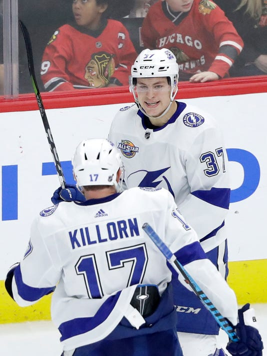 Tampa Bay Lightning's Yanni Gourde (37) celebrates his goal with Alex Killorn during the third period of an NHL hockey game against the Chicago Blackhawks, Monday, Jan. 22, 2018, in Chicago. (AP Photo/Charles Rex Arbogast)