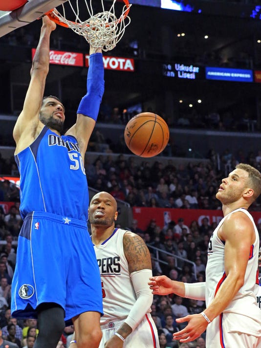 Dallas Mavericks center Salah Mejri (50) dunks over forward Blake Griffin (32) in the second half of an NBA basketball game in Los Angeles, Wednesday, April 5, 2017. The Clippers won 112-101. (AP Photo/Reed Saxon)