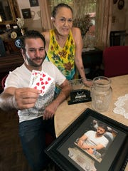 Pensacola Poker Player, John Langevin shows off his favorite card hand with his mother, Josephine, by his side Wednesday, Aug. 16, 2017. Langevin recently won at a poker tournament in Miss. and used the winnings to pay his mother's medical bills.