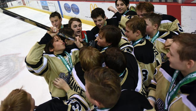 Detroit Honeybaked forward Max Jelavic kisses the Silver Stick Sunday, Jan. 16, after his team won the PeeWee AAA Silver Stick Final Championship at McMorran Arena in Port Huron.