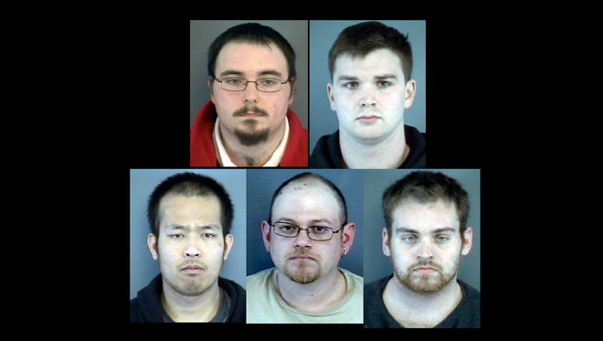 (Top): David A. Good Jr., 23, Grottoes; and Joseph F. Corrigan, 21, of Vienna. (Bottom): Michael B. Boupharak, 25, of Timberville; Kevin W. Hitt, 30, of Grottoes; and Christopher B. Hughes, 24, of Ridgeway.