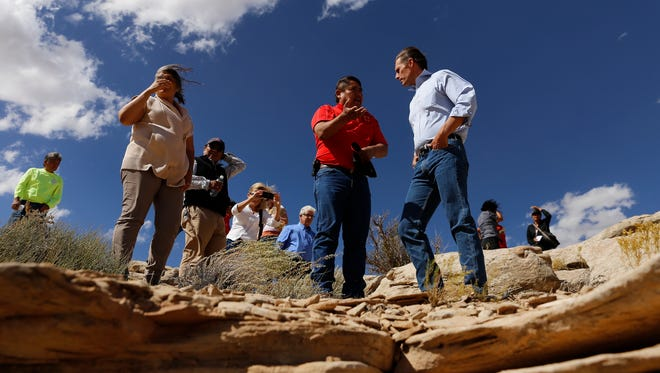 Senator Martin Heinrich talks with Gilbert Dayzie, civil engineer with the Shiprock AML Reclamation Program on Oct. 2 during a tour of a uranium mine in Oaksprings.