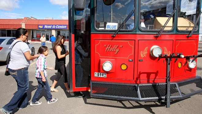 Passengers board the blue line bus on Friday at the Red Apple Transit stop on Farmington Avenue.