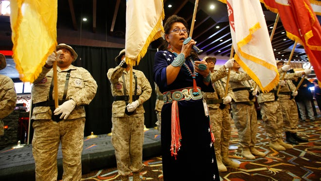 Northern Edge Navajo Casino employee Claire King sings the National Anthem, Wednesday during a Veterans Day ceremony at  the casino in Fruitland.