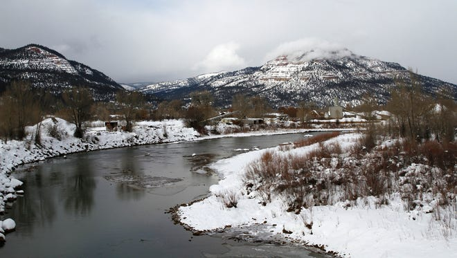 Snow covers the La Plata Mountains surrounding the Animas River near Durango, Colo.