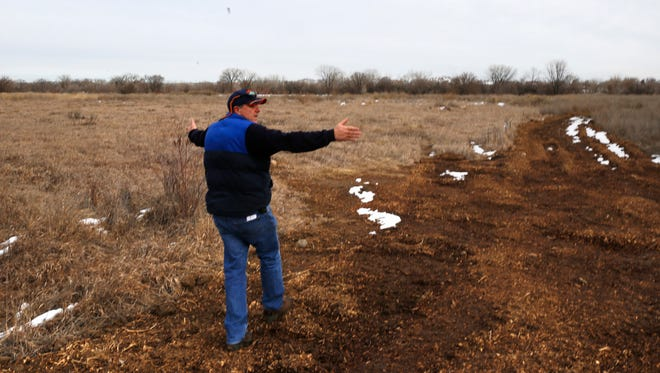 Ken George, director of the Aztec Electric Department, on Jan. 19, shows the boundary of a piece of property where a solar farm will be located in Aztec.