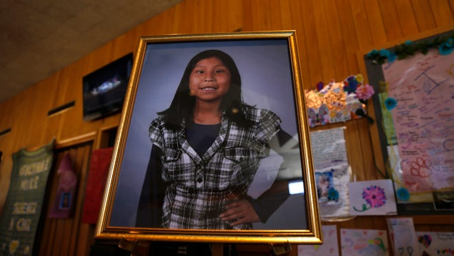 A portrait of Ashlynne Mike was on display Friday inside the lobby of the Farmington Civic Center during a funeral ceremony for the 11-year-old.